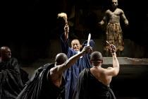 JULIUS CAESAR   by Shakespeare   design: Michael Vale   lighting: Vince Herbert   director: Gregory Doran   the assassins strike - left: : Andrew French (Decius Brutus)   centre:  Jeffery Kissoon (Ju...