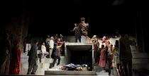 JULIUS CAESAR   by Shakespeare   design: Michael Vale   lighting: Vince Herbert   director: Gregory Doran   Marcus Brutus addresses the crowd: (top centre) Paterson Joseph (Marcus Brutus) with Caesar...