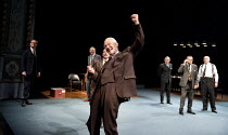 DEMOCRACY   by Michael Frayn   design: Simon Daw   lighting: Mark Doubleday   director: Paul Miller   celebrating election victory - centre (front): William Hoyland (Herbert Wehner), (behind him) Aid...