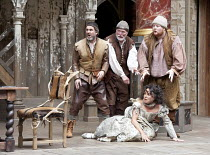 THE TAMING OF THE SHREW   by Shakespeare   design: Mike Britton   director: Toby Frow ~IV/i - rear, l-r: Tom Anderson (Curtis), David Beames (servant), Chris Keegan (Nathaniel) with Samantha Spiro (Ka...