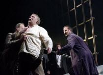 GOTTERDAMMERUNG  by Wagner   conductor: Anthony Negus   design: Kjell Torriset   lighting: Ben Ormerod   director: Alan Privett   Hagen kills Siegfried - left: Mati Turi (Siegfried)   right: Stuart P...