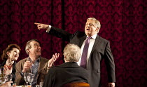 TIMON OF ATHENS   by Shakespeare   design: Tim Hatley   lighting: Bruno Poet   director: Nicholas Hytner ~Simon Russell Beale (Timon of Athens) with (left) Lynnette Edwards (Sempronia), Nick Sampson (...