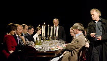 TIMON OF ATHENS   by Shakespeare   design: Tim Hatley   lighting: Bruno Poet   director: Nicholas Hytner ~at head of the table: Simon Russell Beale (Timon of Athens)    right: Hilton McRae (Apemantus)...