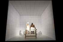 LOVE AND INFORMATION   by Caryl Churchill   set design: Miriam Buether   costumes: Laura Hopkins   lighting: Peter Mumford   director: James Macdonald ~'Maths': Amanda Drew, Rashan Stone~Jerwood Theat...