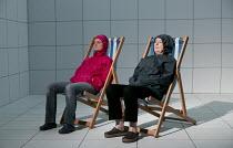 LOVE AND INFORMATION   by Caryl Churchill   set design: Miriam Buether   costumes: Laura Hopkins   lighting: Peter Mumford   director: James Macdonald   'Depression' - l-r: Sarah Woodward, Linda Bass...