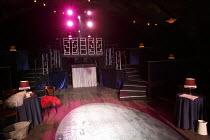 VICTOR/VICTORIA   book: Blake Edwards   music: Henry Mancini   design: Martin Thomas   lighting: Howard Hudson   director: Thom Southerland ~stage,set,empty,club,interior,table,lamp~Southwark Playhous...