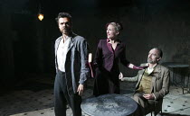 LOT AND HIS GOD   by Howard Barker   design: Fotini Dimou   lighting: Peter Mumford   director: Robyn Winfield-Smith ~~l-r: Justin Avoth (Drogheda), Hermione Gulliford (Sverdlosk), Mark Tandy (Lot)~Th...