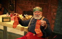 FATHER CHRISTMAS   by Raymond Briggs   adapted by Pins & Needles   design: Zoe Squire   director: Emma Earle   not thrilled with socks present: Barry McCarthy (Father Christmas)  Lyric Hammersmith (...