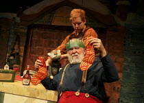 FATHER CHRISTMAS   by Raymond Briggs   adapted by Pins & Needles   design: Zoe Squire   director: Emma Earle   not too happy with the socks: Barry McCarthy (Father Christmas) with David Emmings (pupp...