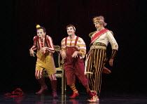 KOOZA   set design: Stephane Roy   costumes: Marie-Chantale Vaillancourt   makeup: Florence Cornet   lighting: Martin Labrecque   writer & director: David Shiner   l-r: 'Obnoxious American' (Roch), '...