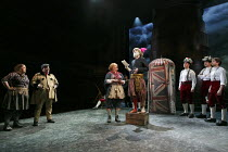 THE WINTER'S TALE   by Shakespeare   design: William Dudley   lighting: Oliver Fenwick   director: Lucy Bailey ~IV/iv - left: Charlotte Mills (Mopsa), Nick Holder (Young Shepherd)   centre: Sally Bank...