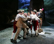 THE WINTER'S TALE   by Shakespeare   design: William Dudley   lighting: Oliver Fenwick   director: Lucy Bailey ~IV/iv - front left: Nick Holder (Young Shepherd)   rear right: Pearce Quigley (Autolycus...