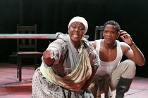 MIES JULIE   adapted & directed by Yael Farber   after Strindberg's 'Miss Julie' ~Thoko Ntshinga (Christine), Bongile Mantsai (John)~Baxter Theatre Centre production / Riverside Studios, London W6   1...