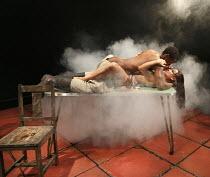 MIES JULIE   adapted & directed by Yael Farber   after Strindberg's 'Miss Julie' ~Bongile Mantsai (John), Hilda Cronje (Mies Julie) ~Baxter Theatre Centre production / Riverside Studios, London W6   1...