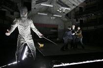 HAMLET   by Shakespeare   design: Jon Bausor   lighting: Jon Clark   director: David Farr   I/iv - l-r: Greg Hicks (Ghost of Old Hamlet), Samuel Taylor (Marcellus), Jonathan Slinger (Hamlet), Alex Wa...