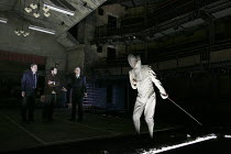 HAMLET   by Shakespeare   design: Jon Bausor   lighting: Jon Clark   director: David Farr   I/iv - l-r: Samuel Taylor (Marcellus), Alex Waldman (Horatio), Jonathan Slinger (Hamlet), Greg Hicks (Ghost...
