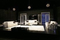 SMACK FAMILY ROBINSON   by Richard Bean   design: James Cotterill   lighting: Johanna Town   director: Richard Wilson ~stage,set,empty,interior,living room,settee,sofa,door,doors,lights~Rose Theatre K...