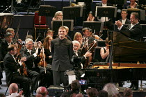 2013 BBC Proms   Prom #1   (centre) Stephen Hough (piano) & (upper right) Sakari Oramo (conductor) acknowleding applause after perforamnce of Rhapsody on a Theme of Paganini (Rachmaninov) BBC Symph...