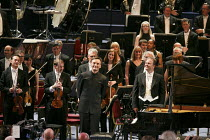 2013 BBC Proms   Prom #1   Stephen Hough (piano) & Sakari Oramo (conductor) acknowleding applause after perforamnce of Rhapsody on a Theme of Paganini (Rachmaninov) BBC Symphony Orchestra: conducto...
