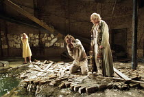 THE TEMPEST   by Shakespeare   design: Paul Brown   lighting: Mark Henderson   director: Jonathan Kent   l-r: Anna Livia Ryan (Miranda), Malcolm Storry (Caliban), Ian McDiarmid (Prospero) Almeida Th...