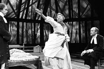 THE CRUCIBLE   by Arthur Miller   design: Shelagh Keegan   lighting: Paul Denby   director: David Thacker ~l-r: Geoffrey Beevers (Reverend Parris), Mona Hammond (Tituba), Hugh Ross (Reverend John Hale...