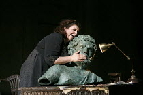 ELEKTRA   by Richard Strauss   conductor: Andris Nelsons   set design, lighting & direction: Charles Edwards   costumes: Brigitte Reifenstuel   Christine Goerke (Elektra) with a bust of her father, A...