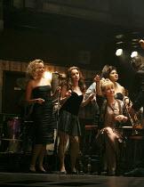 THE COMMITMENTS   by Roddy Doyle   design: Soutra Gilmour   lighting: Jon Clark   choreography: Ann Yeedirector: Jamie Lloyd ~standing, l-r: Stephanie McKeon (Natalie), Sarah O'Connor (Imelda), Jessic...