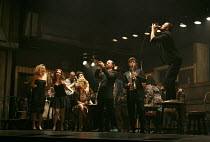 THE COMMITMENTS   by Roddy Doyle   design: Soutra Gilmour   lighting: Jon Clark   choreography: Ann Yeedirector: Jamie Lloyd ~right, on table: Killian Donnelly (Deco)~Palace Theatre, London W1   08/10...