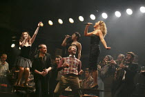THE COMMITMENTS   by Roddy Doyle   design: Soutra Gilmour   lighting: Jon Clark   choreography: Ann Yeedirector: Jamie Lloyd ~2nd left: Killian Donnelly (Deco)   on tables, l-r: Sarah O'Connor (Imelda...