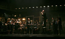 THE COMMITMENTS   by Roddy Doyle   design: Soutra Gilmour   lighting: Jon Clark   choreography: Ann Yeedirector: Jamie Lloyd ~right, on table: Killian Donnelly (Deco)  ~Palace Theatre, London W1   08/...