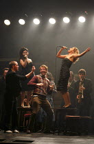 THE COMMITMENTS   by Roddy Doyle   design: Soutra Gilmour   lighting: Jon Clark   choreography: Ann Yeedirector: Jamie Lloyd ~front left: Killian Donnelly (Deco)   on tables, l-r: Jessica Cervi (Berni...