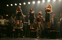 THE COMMITMENTS   by Roddy Doyle   design: Soutra Gilmour   lighting: Jon Clark   choreography: Ann Yeedirector: Jamie Lloyd ~on tables, l-r: Sarah O'Connor (Imelda), Jessica Cervi (Bernie), Stephanie...