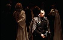 MACBETH   by Shakespeare   design: John Napier   lighting: Leo Leibovici   director: Trevor Nunn ~Ian McKellen (Macbeth) with (rear left, in white) Griffith Jones (Duncan, King of Scotland)~Royal Shak...