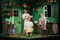 EMIL AND THE DETECTIVES   by Erich Kastner   adapted by Carl Miller   design: Bunny Christie   lighting: Lucy Carter   director: Bijan Sheibani ~l-r: (rear) Naomi Frederick (Ida), Tamzin Griffin (Mrs...