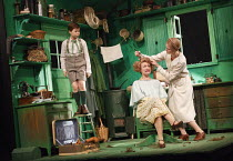 EMIL AND THE DETECTIVES   by Erich Kastner   adapted by Carl Miller   design: Bunny Christie   lighting: Lucy Carter   director: Bijan Sheibani ~l-r: Ethan Hammer (Emil), Tamzin Griffin (Mrs Wirth), N...
