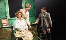 EMIL AND THE DETECTIVES   by Erich Kastner   adapted by Carl Miller   design: Bunny Christie   lighting: Lucy Carter   director: Bijan Sheibani ~l-r: Tamzin Griffin (Mrs Wirth), Naomi Frederick (Ida),...