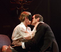 FROM MORNING TO MIDNIGHT   by Georg Kaiser   design: Soutra Gilmour   lighting: Bruno Poet   director: Melly Still   Victoria Moseley (Harlequin), Adam Godley (Clerk) Lyttelton Theatre / National Th...