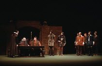 MUCH ADO ABOUT NOTHING   by Shakespeare   design: Alison Chitty   lighting: Stephen Wentworth   director: Peter Gill    seated at table: Leonard Fenton (Verges), Brian Glover (Dogberry) Olivier The...