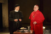 WOLF HALL   by Hilary Mantel   adapted by Mike Poulton   design: Christopher Oram   lighting: Paule Constable   director: Jeremy Herrin   l-r: Ben Miles (Thomas Cromwell), Paul Jesson (Cardinal Wolse...