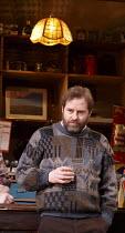 THE WEIR   by Conor McPherson   design: Tom Scutt   lighting: Neil Austin   director: Josie Rourke ~Ardal O'Hanlon (Jim)~Donmar Warehouse 2013 production / Wyndham's Theatre, London WC2   21/01/2014