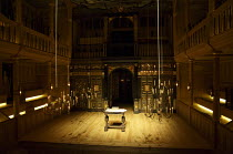 interior,stage,pit,auditorium,galleries,candelabra,candles,lantern,desk - candelabra in lowered position for lighting, rear stage left being raised into position Sam Wanamaker Playhouse / Shakespeare...