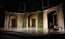 DONKEY'S YEARS   by Michael Frayn   design: Polly Sullivan   lighting: Emma Chapman   director: Lisa Spirling ~stage,set,empty,exterior,Oxford,college,bicycle~Rose Theatre Kingston / Surrey, England...