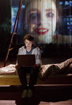 SPRING AWAKENING   by Frank Wedekind   in a new version by Anya Reiss   design: Colin Richmond   lighting: Malcolm Rippeth   director: Ben Kidd   Bradley Hall (Moritz Stiefel) with video image of Ils...