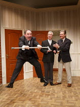 TWO INTO ONE   written & directed by Ray Cooney   design: Julie Godrey   lighting: Paul Anderson   l-r: Nick Wilton (George Pigden), Jeffrey Holland (Manager), Michael Praed (Richard Willey) Menier...