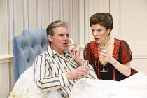 TWO INTO ONE   written & directed by Ray Cooney   design: Julie Godrey   lighting: Paul Anderson   Michael Praed (Richard Willey), Josefina Gabrielle (Pamela Willey) Menier Chocolate Factory / Londo...