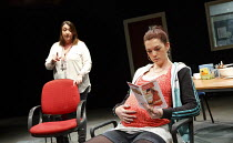 l-r: Ashley McGuire (Sharon), Grace Savage (Jade) in HOME written & directed by Nadia Fall at The Shed, National Theatre (NT), London SE1  31/03/2014  design: Ruth Sutcliffe   lighting: Ciaran Bagnal...