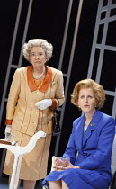 HANDBAGGED   by Moira Buffini   design: Richard Kent   lighting: Oliver Fenwick   director: Indhu Rubasingham   l-r: Marion Bailey (Q), Fenella Woolgar (Mags) Tricycle Theatre NW6 2013 production /...