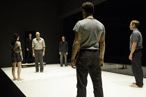 A VIEW FROM THE BRIDGE   by Arthur Miller   set & lighting design: Jan Versweyveld   costumes: An D'Huys   director: Ivo Van Hove ~left: Phoebe Fox (Catherine)   front centre: Mark Strong (Eddie Carbo...
