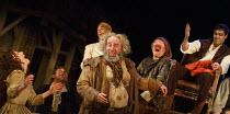 HENRY IV part i   by Shakespeare   design: Stephen Brimson Lewis   lighting: Tim Mitchell   director: Gregory Doran ~Tavern scene - centre : Antony Sher (Sir John Falstaff)   right: Alex Hassell (Henr...