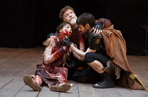 TITUS ANDRONICUS   by Shakespeare   design: William Dudley   director / Master of Play': Lucy Bailey ~l-r: Flora Spencer-Longhurst (Lavinia), William Houston (Titus Andronicus), Dyfan Dwyfor (Lucius)...